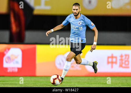 Belgian football player Yannick Ferreira Carrasco of Dalian Yifang dribbles against Beijing Renhe in their 15th round match during the 2019 Chinese Football Association Super League (CSL) in Beijing, China, 29 June 2019. Dalian Yifang defeated Beijing Renhe 3-1. - Stock Photo