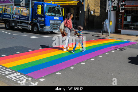 Wimbledon  UK 01 July 2019Wimbledon is painting the town rainbow ,ahead of Pride London this week end. A pedestrian crossing painted with rainbow colours in Wimbledon high Street.Paul Quezada-Neiman/Alamy Live News - Stock Photo