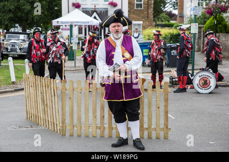 Datchet, UK. 30 June, 2019. Chris Brown, Official Town Crier of the Royal Borough of Windsor and Maidenhead, announces a performance by Datchet Border - Stock Photo
