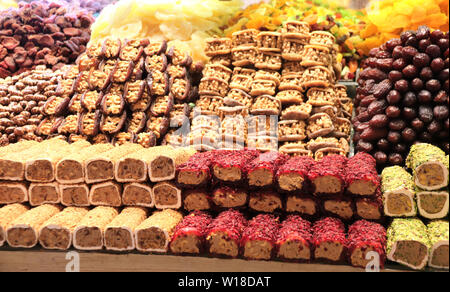 Traditional turkish delights from nuts, sugar, syrup and dried fruits on the Egyptian bazaar, Istanbul - Stock Photo