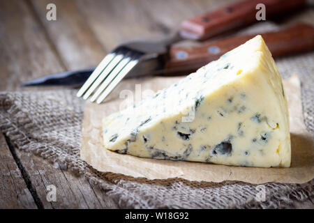 Blue cheese on wooden rustic table. - Stock Photo