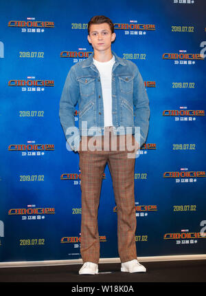 Seoul, South Korea. 1st July, 2019. Actor Tom Holland poses for photos during a promotion activity of the film 'Spider-Man: Far From Home' in Seoul, South Korea, July 1, 2019. The movie will be released in South Korea on July 2. Credit: Lee Sang-ho/Xinhua/Alamy Live News - Stock Photo