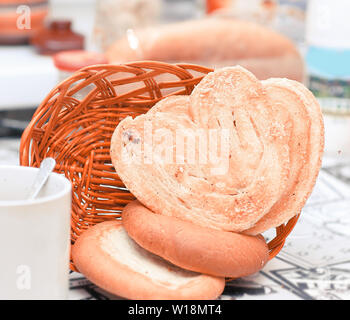 close up.a Cup of tea and homemade cakes on the background of the kitchen table. - Stock Photo