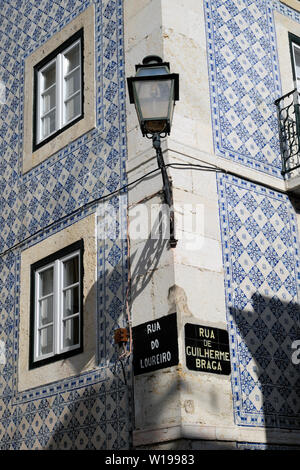 Vertical view of historic gas lamp on blue tiled building on corner and Portuguese  street signs in Alfama Lisbon Portugal Europe  KATHY DEWITT - Stock Photo