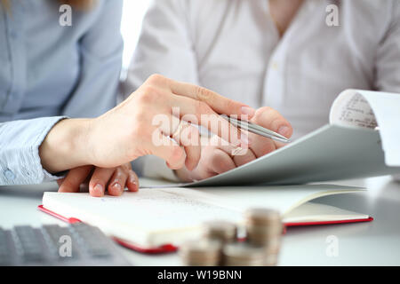 A couple checks checks to deduct taxes from - Stock Photo
