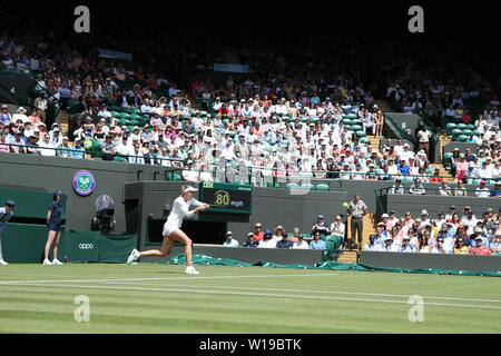 London, UK. 01st July, 2019. Wimbledon Tennis Tournament, Day 1; Aliaksandra Sasnovich (Belarus) returns during her match versus Simona Halep (rou) Credit: Action Plus Sports Images/Alamy Live News - Stock Photo