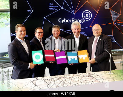Essen, Germany. 01st July, 2019. Florian Haacke, Head of Group Security Innogy SE, Thomas Kufen (CDU. l-r), Lord Mayor of Essen, Uwe Tiggers, Chairman of the Board of Innogy SE, Andreas Pinkwart (FDP), NRW Minister of Economics, Innovation, Digitization and Energy and Arne Schönbohm, President of the Federal Office for Information Security, officially inaugurate the Innogy SE training center. The energy company Innogy presents its training center for the defense against cyber attacks on power grids. Credit: Roland Weihrauch/dpa/Alamy Live News - Stock Photo