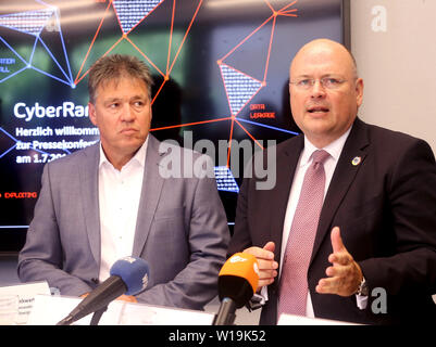 Essen, Germany. 01st July, 2019. Uwe Tiggers (l), CEO of Innogy SE, and Arne Schönbohm, President of the Federal Office for Information Security, answer journalists' questions at the press conference on the occasion of the inauguration of the Innogy Training Centre. The energy company Innogy presents its training center for the defense against cyber attacks on power grids. Credit: Roland Weihrauch/dpa/Alamy Live News - Stock Photo