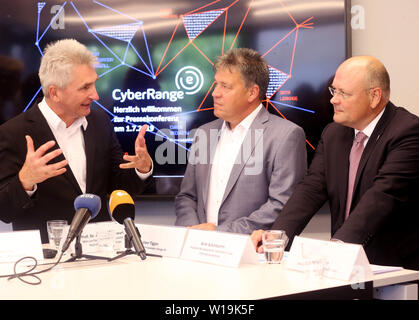 Essen, Germany. 01st July, 2019. Andreas Pinkwart (FDP, l-r), NRW Minister of Economics, Innovation, Digitisation and Energy, Uwe Tiggers, CEO of Innogy SE, and Arne Schönbohm, President of the Federal Office for Information Security, answer journalists' questions at the press conference on the occasion of the inauguration of the Innogy training centre. The energy company Innogy presents its training center for the defense against cyber attacks on power grids. Credit: Roland Weihrauch/dpa/Alamy Live News - Stock Photo