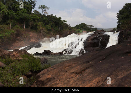 Bumbuna Falls on rapids of River Rokel in bush amongst lush vegetation of rain forest near Bumbuna village, Sierra Leone - Stock Photo