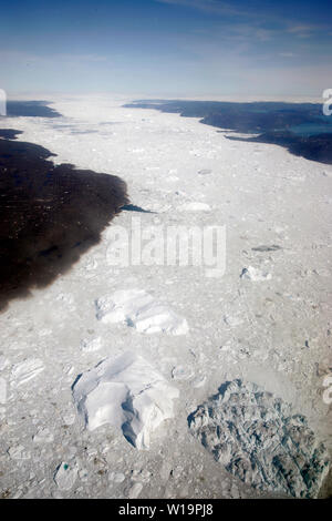 Melting ice from the world's fastest moving glacier, the Jakobshavn Glacier near Ilulissat on Greenland. Global warming have accellerated the melting and calving of the ice bergs. - Stock Photo