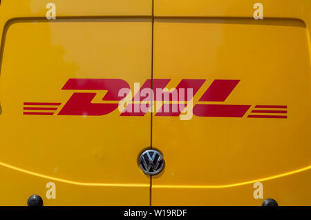 DHL Company Van On The Back At Amsterdam The Netherlands 2019 - Stock Photo