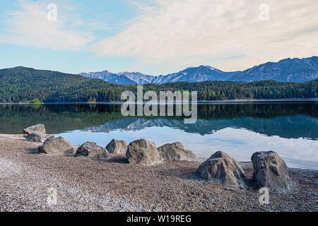 Eibsee Garmisch Partenkirchen rocks on the shore - Stock Photo