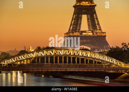Paris, 75016, FRANCE: Eiffel Tower and Rouelle Bridge at Sunrise with the Basilica of the Sacre Coeur in the distance. Ile-aux-Cygne - Stock Photo