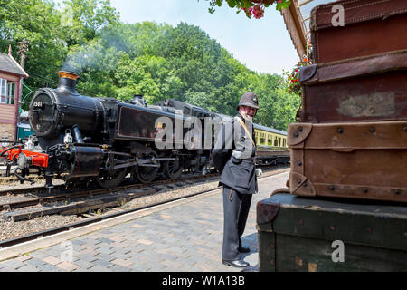Kidderminster, UK. 29th June, 2019. Severn Valley Railways 'Step back to the 1940's' gets off to a fabulous start this weekend with costumed re-enactors playing their part in providing an authentic recreation of wartime Britain. A vintage policeman sweltering on duty in full uniform ensures a British Bobby is always present. Credit: Lee Hudson - Stock Photo