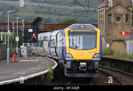 First day in passenger service with Northern Rail for CAF built class 195 Civity diesel multiple unit at Carnforth station on Monday 1st July 2019. - Stock Photo