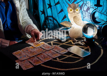 The necromancer reads the cards and predicts the future - Stock Photo