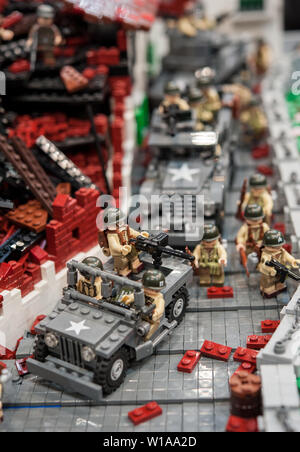 Detail of war theatre plastic model, with military jeep and destroyed buildings - Stock Photo