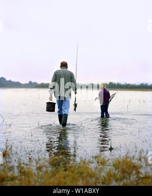 Father and daughter going fishing - Stock Photo