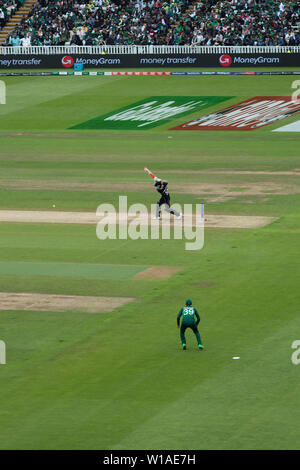 28th June 2019 - New Zealand batsman punching the ball to mid-off during their 2019 ICC Cricket World Cup game against Pakistan at Edgbaston - Stock Photo