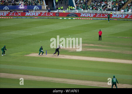 28th June 2019 - New Zealand batsman punching the ball to cover point during their 2019 ICC Cricket World Cup game against Pakistan at Edgbaston, UK - Stock Photo