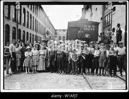 A part of the spinning force working in the Washington Cotton Mills. Group posed by overseer. All work. The overseer said, These boys are a bad lot. All were alive to the need for being 14 years old, when questioned. Fries, Va. - Stock Photo