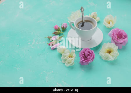 morning cup of coffee and fresh beautiful pink and white roses flowers ,flat layout, copy space.Coffee drink concept with cup of americano and roses - Stock Photo