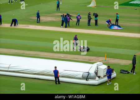 28th June 2019 - Ground staff prepare the wicket prior to the New Zealand verses Pakistan in the 2019 ICC World Cup held in England and Wales - Stock Photo