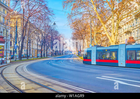 VIENNA, AUSTRIA - FEBRUARY 18, 2019: The tram rides along the Ringstrasse, one of the most famous boulevards of the city with famous buildings along i - Stock Photo
