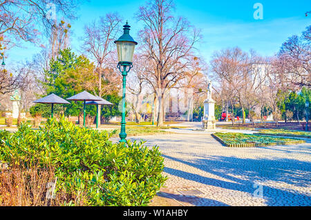 The wide alley in Stadtpark (City park), that is one of the most comfortable places to relax in Vienna, Austria - Stock Photo