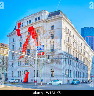 VIENNA, AUSTRIA - FEBRUARY 18, 2019: The facade of the historical Library of University for Applied Art with unusual modern decoration, on February 18 - Stock Photo