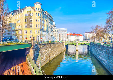 VIENNA, AUSTRIA - FEBRUARY 18, 2019: The view on the stone banks of Wein River with historical buildings and the tonel of the metro Zollamtsbrücke bri - Stock Photo