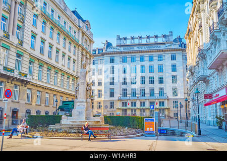 VIENNA, AUSTRIA - FEBRUARY 18, 2019: The small squre with monument to Georg Coch and huge Austrian Postal Savings Bank on the background, on February - Stock Photo