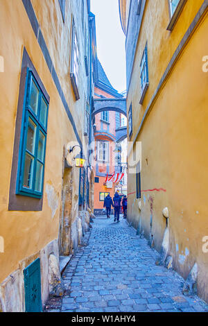VIENNA, AUSTRIA - FEBRUARY 18, 2019: The tiny Griechengasse street in Greek historical district is one of the most hidden tourist landmarks in the cit - Stock Photo
