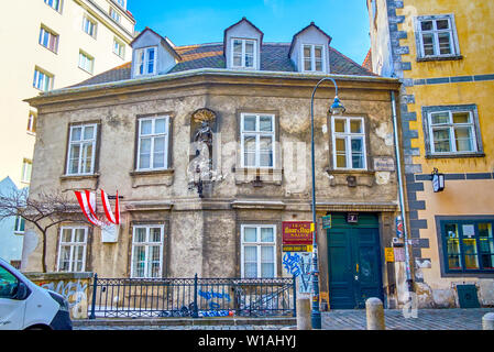 VIENNA, AUSTRIA - FEBRUARY 18, 2019: The small Burgerhaus historic Gothic House with sculpture of the Saint hidden in the maze of medieval streets of - Stock Photo
