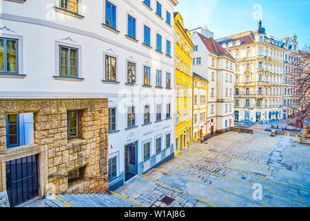 VIENNA, AUSTRIA - FEBRUARY 18, 2019: The medieval Am Gestade area in old town with large staircases and historical mansions on it side, lead to newer