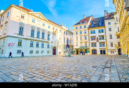 VIENNA, AUSTRIA - FEBRUARY 18, 2019: The large historical Judenplatz square surrounded with beautiful mansions and sculpture of Lessing in the middle, - Stock Photo
