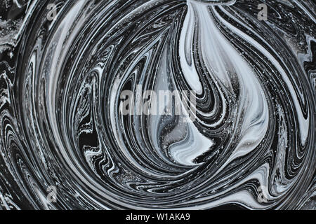 abstract image mixing of two colors. The texture of the circles of white and black paint - Stock Photo