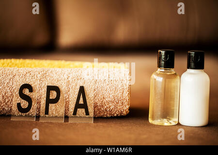 Chocolate Spa. Composition brown towel in hotel room of spa treatment. - Stock Photo