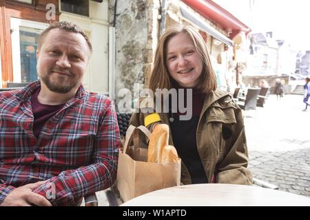 dad and daughter at the traditional french caffee. Morlaix, France - Stock Photo