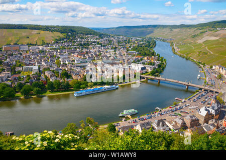 BERNKASTEL-KUES, RHINELAND-PALATINATE, GERMANY – MAY 31, 2019: Aerial view of the western side of the town, the Moselle river and the surrounding vine - Stock Photo