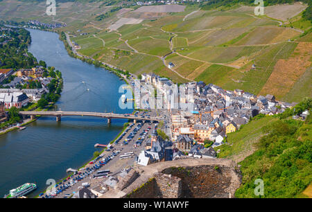 BERNKASTEL, RHINELAND-PALATINATE, GERMANY – MAY 31, 2019: Aerial view of the eastern side of the town, the Moselle river and the surrounding vineyards - Stock Photo