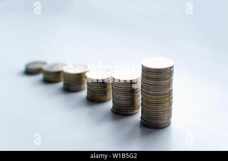 Increasing columns of coins, step of stacks coin isolated on white background with copy space for business and financial concept idea. - Stock Photo