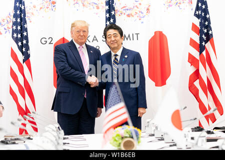 Osaka, United States Of America. 27th June, 2019. President Donald J. Trump shakes hands with the Prime Minister of Japan Shinzo Abe in a bilateral meeting at the G20 Summit Friday, June 28, 2019, in Osaka, Japan. People: President Donald Trump, Prime Minister of Japan Shinzo Abe Credit: Storms Media Group/Alamy Live News - Stock Photo