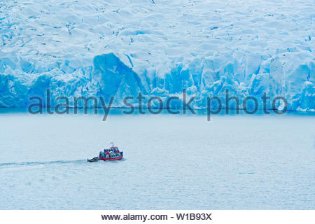 Boat by icebergs, Gray Lake, Torres del Paine National Park, Patagonian Andes, Patagonia, Chile, South America - Stock Photo