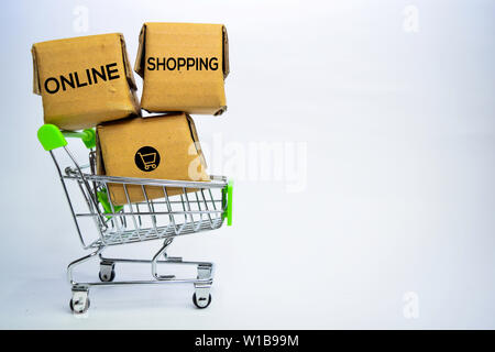 Online Shopping Text in small boxes and shopping cart. Concepts about online shopping. Isolated on white background - Stock Photo