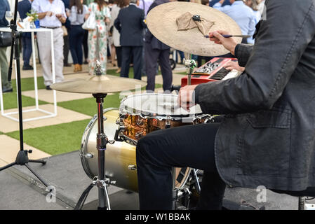 Valencia, Spain - June 20, 2019: Musician playing jazz to the battery hired to entertain the attendees of a business event. - Stock Photo
