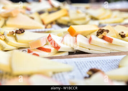 Buffet of cheeses of many types on a table served in Mediterranean diners. - Stock Photo