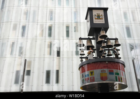 Swiss Glockenspiel at Leicester Square with M&M's World modern glass building in background at Westminster London England