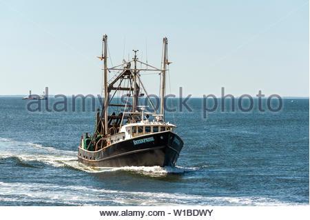 New Bedford, Massachusetts, USA - July 1, 2019: Clammer Enterprise returning to New Bedford on summer morning - Stock Photo